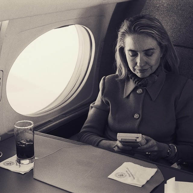hillary_rodham_clinton_playing_a_nintendo_game_boy_video_game_on_the_flight_from_austin_en_route_to_washington2c_dc